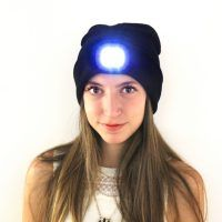 Kikkerland LED Light Up beanie hat on female model